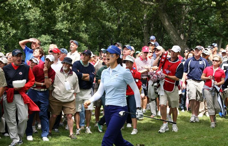 SUGAR GROVE, IL - AUGUST 21:  Michelle Wie of the USA hits a remarkable 3 wood second shot from the trees at the 15th hole during the Friday morning fourball matches at the 2009 Solheim Cup Matches, at the Rich Harvest Farms Golf Club on August 21, 2009 in Sugar Grove, Ilinois  (Photo by David Cannon/Getty Images)