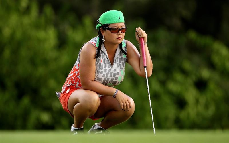 SINGAPORE - FEBRUARY 25:  Christina Kim of the USA lines up a putt on the fifth hole during the first round of the HSBC Women's Champions at the Tanah Merah Country Club on February 25, 2010 in Singapore.  (Photo by Andrew Redington/Getty Images)