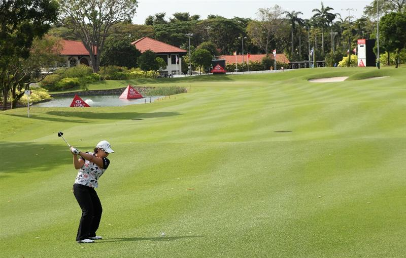 SINGAPORE - FEBRUARY 23:  Jiyai Shin of South Korea plays her second shot on the ninth hole during the Pro Am prior to the start of the HSBC Women's Champions at the Tanah Merah Country Club on February 23, 2011 in Singapore.  (Photo by Andrew Redington/Getty Images)
