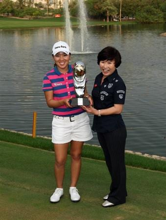 DUBAI, UNITED ARAB EMIRATES - DECEMBER 12:  In Kyung Kim of South Korea holds the trophy with her mother Soo Kee Sung of South Korea after the final round of the Dubai Ladies Masters, on the Majilis Course at the Emirates Golf Club on December 12, 2009 in Dubai, United Arab Emirates.  (Photo by David Cannon/Getty Images)