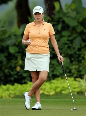 KUALA LUMPUR, MALAYSIA - OCTOBER 21:   Cristie Kerr of USA waits for her turn to putt on the 5th hole during the Sime Darby Pro-Am at the KLGCC Golf Course on October 21, 2010 in Kuala Lumpur, Malaysia (Photo by Stanley Chou/Getty Images)