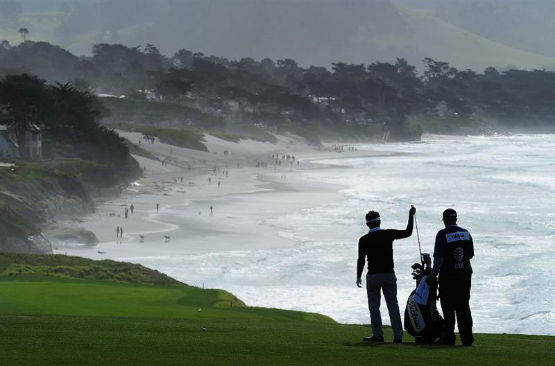PEBBLE BEACH, CA - FEBRUARY 12:  Ryuji Imada of Japan and caddie on the nineth hole during round two of the AT&T Pebble Beach National Pro-Am at Pebble Beach Golf Links on February 12, 2010 in Pebble Beach, California.  (Photo by Stuart Franklin/Getty Images)