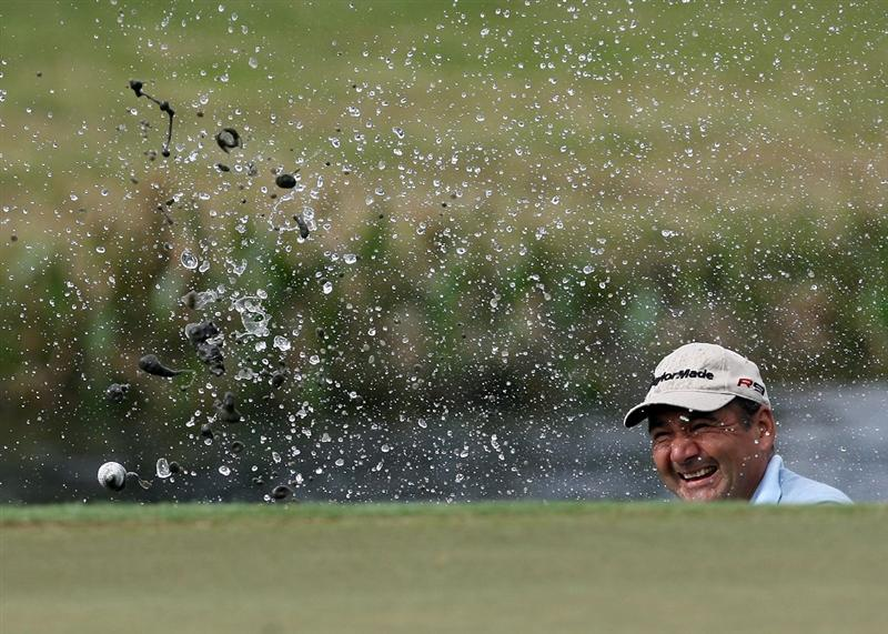 PALM BEACH GARDENS, FL - MARCH 05:  Jose Coceres hits a chip shot out of the water hazard on the 17h hole during the first round of The Honda Classic at PGA National Resort and Spa on March 5, 2009 in Palm Beach Gardens, Florida.  (Photo by Doug Benc/Getty Images)