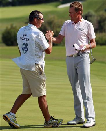 CASARES, SPAIN - MAY 22:  Ian Poulter of England celebrates with caddie Terry Mundy after winning the Volvo World Match Play Championship at Finca Cortesin on May 22, 2011 in Casares, Spain.  (Photo by Andrew Redington/Getty Images)