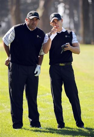 SAN FRANCISCO - OCTOBER 07:  Angel Cabrera (L) and Camilo Villegas of the International Team discuss a shot during a practice round prior to the start of The Presidents Cup at Harding Park Golf Course on October 7, 2009 in San Francisco, California.  (Photo by Harry How/Getty Images)