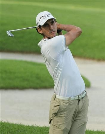 SINGAPORE - NOVEMBER 13: Rafael Cabrera-Bello of Spain hits his 2nd shot on the 18th hole during the Third Round of the Barclays Singapore Open on November 13, 2010 in Singapore, Singapore.  (Photo by Stanley Chou/Getty Images)