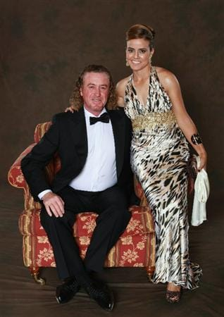 NEWPORT, WALES - SEPTEMBER 29:  Miguel Angel Jimenez of the European Ryder Cup poses with partner Marian Jimenez prior to the 2010 Ryder Cup Dinner at the Celtic Manor Resort on September 29, 2010 in Newport, Wales.  (Photo by David Cannon/Getty Images)