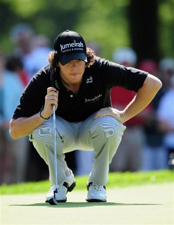 AKRON, OH - AUGUST 06:  Rory McIlroy of Northern Ireland lines up his putt on the 13th hole during the first round of the World Golf Championship Bridgestone Invitational on August 6, 2009 at Firestone Country Club in Akron, Ohio.  (Photo by Stuart Franklin/Getty Images)