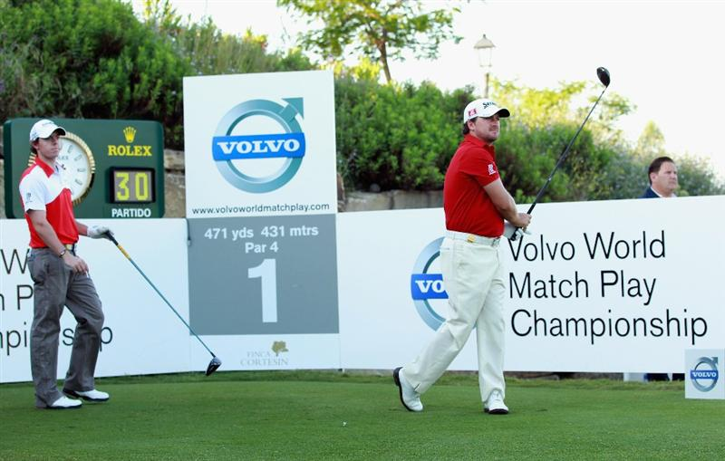 CASARES, SPAIN - MAY 21:  Graeme McDowell of Northern Ireland (right) watches his tee-shot on the first hole as Rory McIlroy of Northern Ireland looks on during their last 16 match at the Volvo World Match Play Championship at Finca Cortesin on May 21, 2011 in Casares, Spain.  (Photo by Andrew Redington/Getty Images)