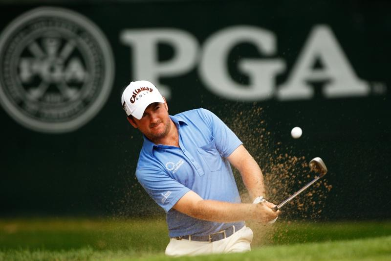 CHASKA, MN - AUGUST 13:  Graeme McDowell of Northern Ireland plays a bunker shot on the 12th hole during the first round of the 91st PGA Championship at Hazeltine National Golf Club on August 13, 2009 in Chaska, Minnesota.  (Photo by Streeter Lecka/Getty Images)