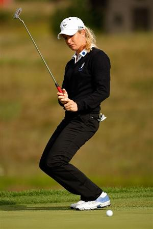 SUGAR GROVE, IL - AUGUST 21:  Suzann Pettersen of the European team reacts to a missed putt for birdie on the second hole during the Friday morning Fourball matches at the 2009 Solheim Cup at Rich Harvest Farms on August 21, 2009 in Sugar Grove, Illinois.  Paula Creamer and Cristie Kerr of the U.S. Team defeated Suzann Pettersen and Sophie Gustafson of the European Team.  (Photo by Chris Graythen/Getty Images)