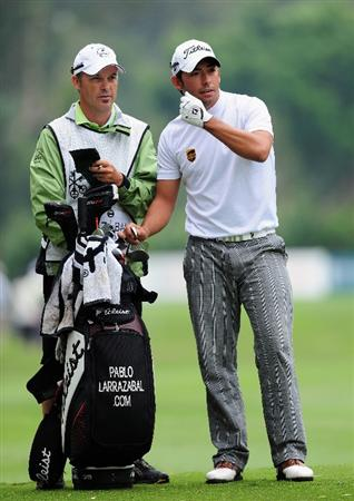 HONG KONG - NOVEMBER 13:  Pablo Larrazabal of Spain and caddie Rod Gutry on the seventh hole during the second round of the UBS Hong Kong Open at the Hong Kong Golf Club on November 13, 2009 in Fanling, Hong Kong.  (Photo by Stuart Franklin/Getty Images)