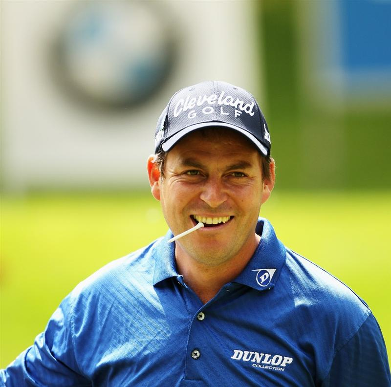 VIRGINIA WATER, ENGLAND - MAY 19:  David Howell of England reacts to a shot during the Pro-Am round prior to the BMW PGA Championship on the West Course at Wentworth on May 19, 2010 in Virginia Water, England.  (Photo by Ian Walton/Getty Images)