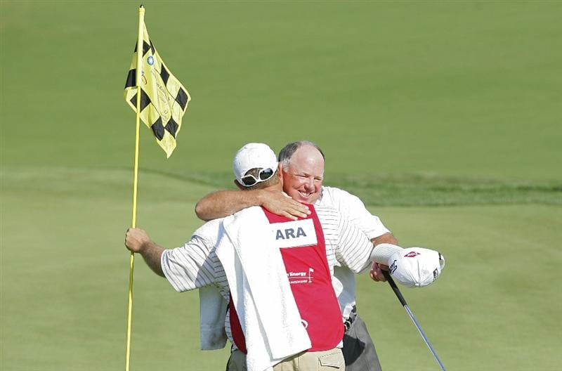 POTOMAC, MD - OCTOBER 10:  Mark O'Meara hugs his caddie Shane Joel on the 18th green after winning the Constellation Energy Senior Players Championship in a one hole playoff at TPC Potomac at Avenel Farm on October 10, 2010 in Potomac, Maryland.  (Photo by Michael Cohen/Getty Images)