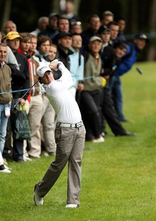VIRGINIA WATER, ENGLAND - MAY 26:  Rory McIlroy of Northern Ireland hits an approach shot during the first round of the BMW PGA Championship at Wentworth Club on May 26, 2011 in Virginia Water, England.  (Photo by Ian Walton/Getty Images)