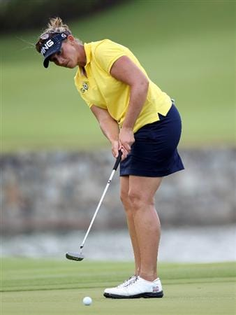 SINGAPORE - FEBRUARY 25:  Angela Stanford of the USA on the 18th green during the first round of the HSBC Women's Champions at the Tanah Merah Country Club on February 25, 2010 in Singapore.  (Photo by Ross Kinnaird/Getty Images)