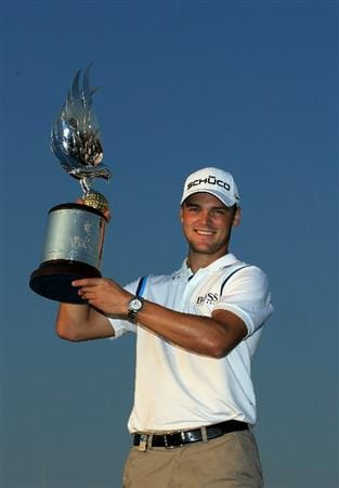 ABU DHABI, UNITED ARAB EMIRATES - JANUARY 23:  Martin Kaymer of Germany holds the trophy after winning the 2011 Abu Dhabi HSBC Golf Championship held at the Abu Dhabi Golf Club on January 23, 2011 in Abu Dhabi, United Arab Emirates.  (Photo by David Cannon/Getty Images)