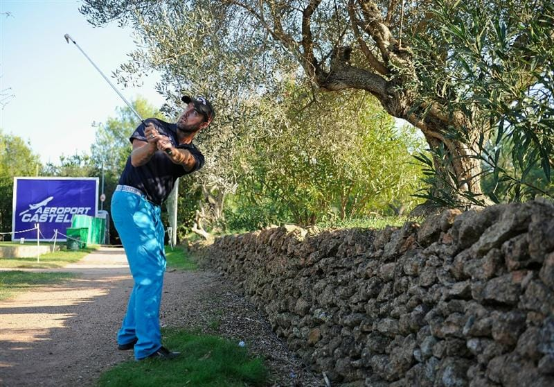 CASTELLON DE LA PLANA, SPAIN - OCTOBER 23:  Christian Nilsson of Sweden prepares to plays his approach shot on the 18th hole from a postion by a wall on the 13th tee during the third round of the Castello Masters Costa Azahar at the Club de Campo del Mediterraneo on October 23, 2010 in Castellon de la Plana, Spain.  (Photo by Stuart Franklin/Getty Images)