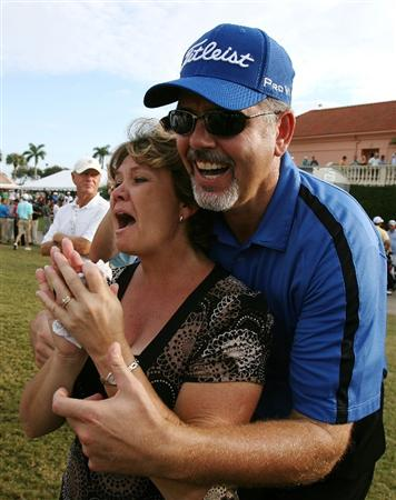 WEST PALM BEACH, FL - DECEMBER 07:  Troy Merritt's parents Zoe Merritt, L, and Mark Merritt cheer as Troy  makes his final putt to become the medalist during the final round of the 2009 PGA TOUR Qualifying Tournament at Bear Lakes Country Club on December 7, 2009 in West Palm Beach, Florida.  (Photo by Doug Benc/Getty Images)