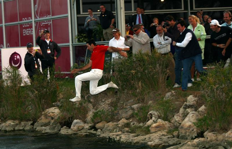 DOHA, QATAR - JANUARY 25:  Alvaro Quiros of Spain is thrown into the lake by the 18th green after winning the Commercialbank Qatar Masters at Doha Golf Club on January 25, 2009 in Doha, Qatar.  (Photo by Andrew Redington/Getty Images)