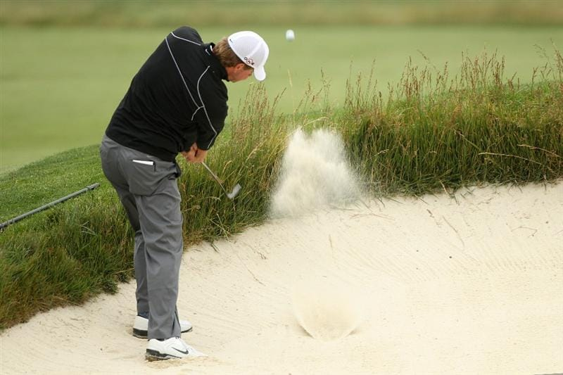 PEBBLE BEACH, CA - JUNE 15:  Lucas Glover hits a bunker shot during a practice round prior to the start of the 110th U.S. Open at Pebble Beach Golf Links on June 15, 2010 in Pebble Beach, California.  (Photo by Scott Halleran/Getty Images)