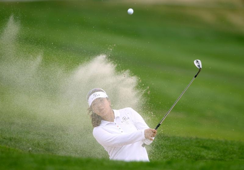 MORELIA, MEXICO- APRIL 24:  Shanshan Feng of China hits out of the 5th green bunker during the second round of the Corona Championship at the Tres Marias Golf Club on April 24, 2009 in Morelia, Michoacan, Mexico. (Photo by Donald Miralle/Getty Images)