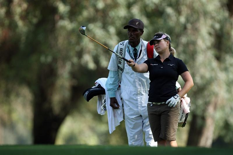 RANCHO MIRAGE, CA - APRIL 02:  Martina Eberl of Germany prepares to play her second shot with her caddy Tom 'Motion' Franks at the 10th hole during the first round of the 2009 Kraft Nabisco Championship, at the Mission Hills Country Club on April 2, 2009 in Rancho Mirage, California.  (Photo by David Cannon/Getty Images)