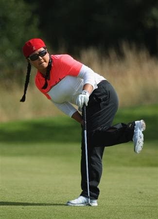 LYTHAM ST ANNES, ENGLAND - AUGUST 02:  Christina Kim of USA watches her third shot on the 11th hole during the final round of the 2009 Ricoh Women's British Open Championship held at Royal Lytham St Annes Golf Club, on August 2, 2009 in Lytham St Annes, England.  (Photo by David Cannon/Getty Images)