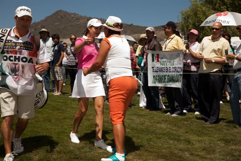 MORELIA, MEXICO - MAY 2: Lorena Ochoa of Mexico embraces Christina Kim during the fourth round of the Tres Marias Championship at the Tres Marias Country Club on May 2, 2010 in Morelia, Mexico. (Photo by Darren Carroll/Getty Images)