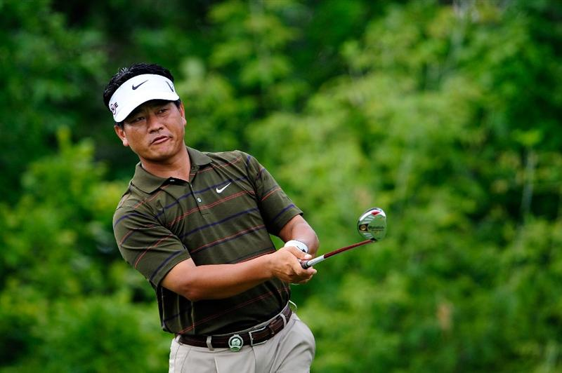 CHASKA, MN - AUGUST 13:  K.J. Choi of South Korea hits his tee shot on the tenth hole during the first round of the 91st PGA Championship at Hazeltine National Golf Club on August 13, 2009 in Chaska, Minnesota.  (Photo by Sam Greenwood/Getty Images)