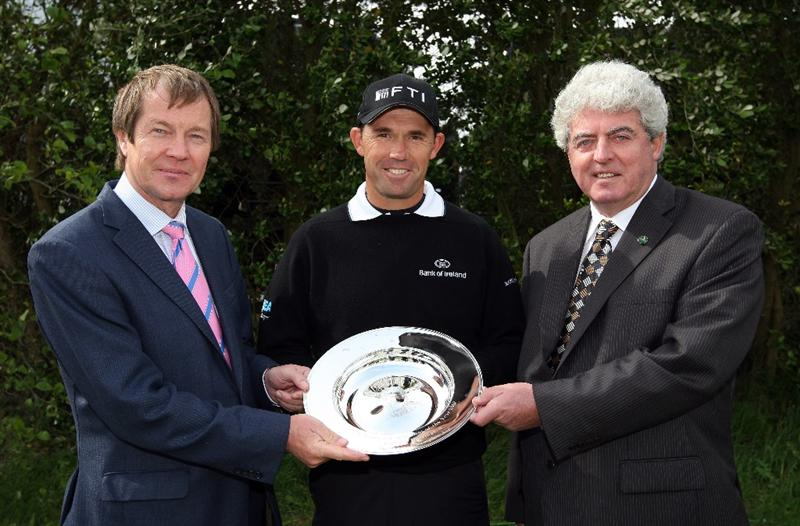BALTRAY, IRELAND - MAY 13:  Padraig Harrington of Ireland (centre) receives his 2008 European Tour Shot of the Year award from George O'Grady (left) and John O'Leary prior to the start of The 3 Irish Open at County Louth Golf Club on May 13, 2009 in Baltray, Ireland.  (Photo by Andrew Redington/Getty Images)
