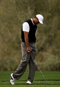MARANA, AZ - FEBRUARY 20:  Tiger Woods reacts to his short approach shot on the seventh hole during the first round matches of the WGC-Accenture Match Play Championship at The Gallery at Dove Mountain on February 20, 2008 in Marana, Arizona.  (Photo by Travis Lindquist/Getty Images)