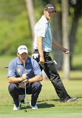 MIAMI, FL - MARCH 11:  Martin Kaymer of Germany (R) waits with Lee Westwood of England on the 16th hole during the second round of the 2011 WGC- Cadillac Championship at the TPC Blue Monster at the Doral Golf Resort and Spa on March 11, 2011 in Doral, Florida.  (Photo by Mike Ehrmann/Getty Images)