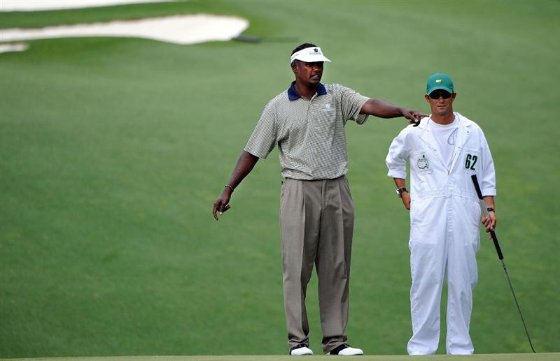 AUGUSTA, GA - APRIL 11:  Vijay Singh of Fiji waits on the tenth hole with his caddie Chad Reynolds during the third round of the 2009 Masters Tournament at Augusta National Golf Club on April 11, 2009 in Augusta, Georgia.  (Photo by Harry How/Getty Images)