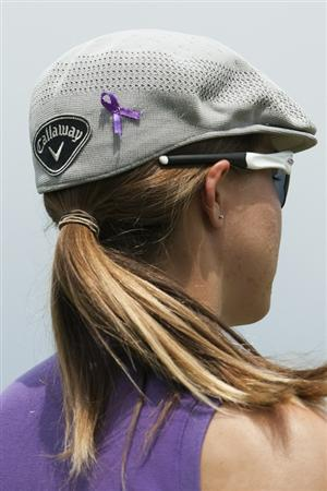 CHON BURI, THAILAND - FEBRUARY 17:  Vicky Hurst of USA wearing a purple ribbon on her Callaway hat during day one of the LPGA Thailand at Siam Country Club on February 17, 2011 in Chon Buri, Thailand.  (Photo by Victor Fraile/Getty Images)