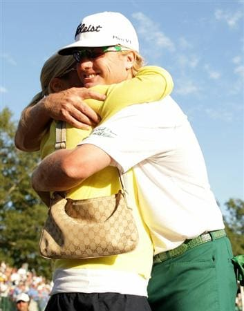 NORTON, MA - SEPTEMBER 06:  (R) Charley Hoffman reacts as he hugs his wife Stacey Hoffman after a birdie on the 18th hole during the final round of the Deutsche Bank Championship at TPC Boston on September 6, 2010 in Norton, Massachusetts.  (Photo by Maxx Wolfson/Getty Images)