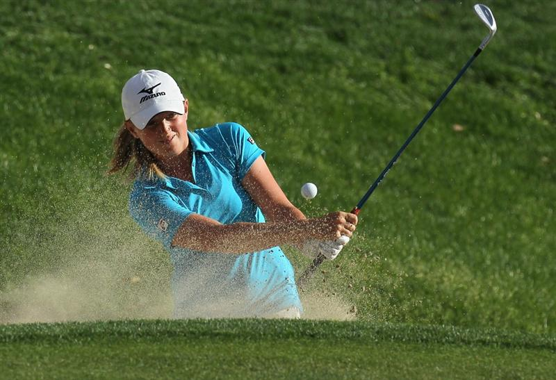 RANCHO MIRAGE, CA - APRIL 02:  Stacy Lewis hits out of a bunker on the 17th hole during the third round of the Kraft Nabisco Championship at Mission Hills Country Club on April 2, 2011 in Rancho Mirage, California.  (Photo by Stephen Dunn/Getty Images)