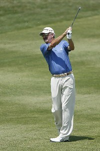 Gary McCord watches an approach shot during the opening round of the Greater Kansas City Golf Classic at the Nicklaus Golf Club at LionsGate in Overland Park, Kansas on June 30, 2006.Photo by G. Newman Lowrance/WireImage.com