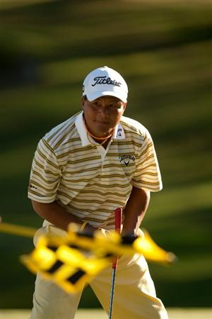 SAN ANTONIO, TX - OCTOBER 29: Chien Soon Lu of Taiwan pull his ball from the cup on the 18th hole during the first round of the AT&T Championship at Oak Hills Country Club on October 29, 2010 in San Antonio, Texas. (Photo by Darren Carroll/Getty Images)