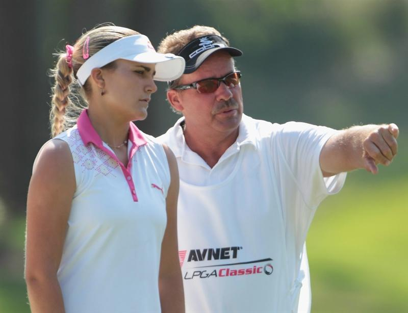 MOBILE, AL - APRIL 30:  Alexis Thompson waits on the 18th green alongside her father/caddie Scottduring the third round of the Avnet LPGA Classic at the Crossings Course at the Robert Trent Jones Trail at Magnolia Grove on April 30, 2011 in Mobile, Alabama.  (Photo by Scott Halleran/Getty Images)