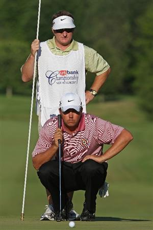 MILWAUKEE - JULY 19: Bo Van Pelt and his caddy Mark Chaney look over a putt on the 18th hole during the final round of the U.S. Bank Championship on July 19, 2009 at the Brown Deer Park golf course in Milwaukee, Wisconsin. Van Pelt won on the second playoff hole. (Photo by Jonathan Daniel/Getty Images)