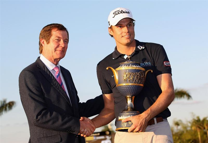DORAL, FL - MARCH 13:  George O'Grady, Chief Executive of The European Tour (L) poses with Nick Watney after the final round of the 2011 WGC- Cadillac Championship at the TPC Blue Monster at the Doral Golf Resort and Spa on March 13, 2011 in Doral, Florida.  (Photo by Sam Greenwood/Getty Images)