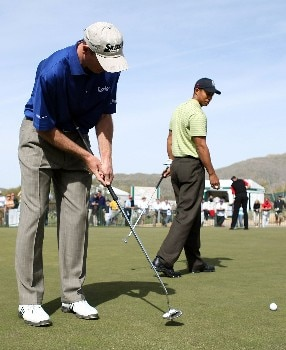 MARANA, AZ - FEBRUARY 18:  Tiger Woods watches as his friend Jim Furyk hits a putt with a belly-putter during a practice round prior to the start of the Accenture Match Play Championship at The Gallery Golf Club at Dove Mountain on February 18, 2008 in Marana, Arizona.  (Photo by Scott Halleran/Getty Images)
