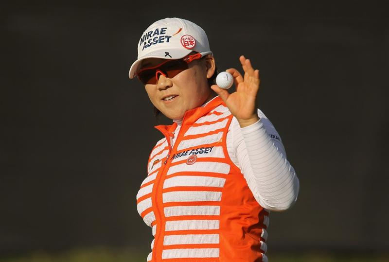 CITY OF INDUSTRY, CA - MARCH 25:  Jiyai Shin of South Korea waves to the gallery on the 18th green after her nine-under par 64 during the second round of the Kia Classic on March 25, 2011 at the Industry Hills Golf Club in the City of Industry, California.  (Photo by Scott Halleran/Getty Images)