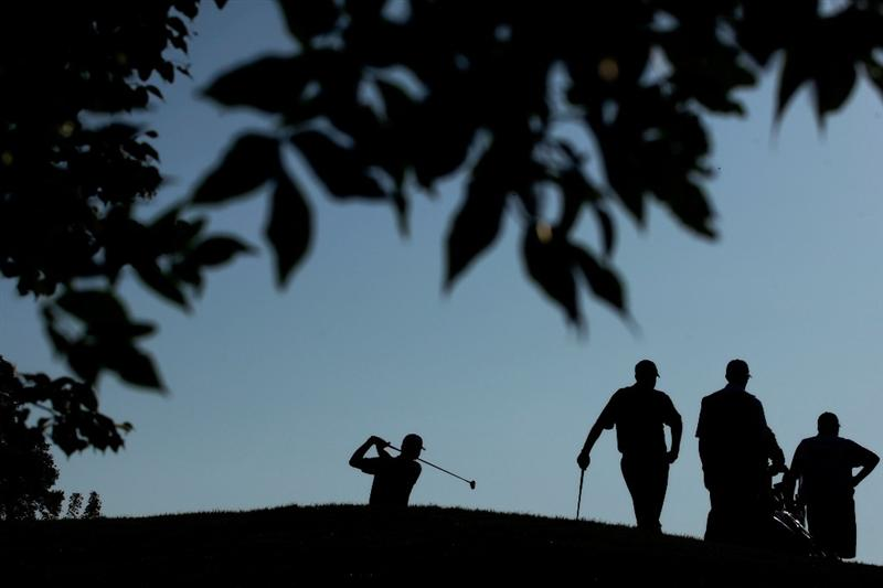 CHASKA, MN - AUGUST 14:  Lucas Glover hits his tee shot on the tenth hole during the second round of the 91st PGA Championship at Hazeltine National Golf Club on August 14, 2009 in Chaska, Minnesota.  (Photo by Jamie Squire/Getty Images)