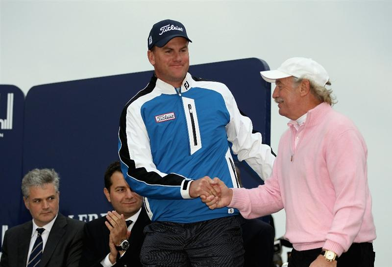 ST ANDREWS, SCOTLAND - OCTOBER 10:  Irish businessman Dermot Desmond is congratulated by his playing partner Robert Karlsson of Sweden after their victory in the team pro-am event during the final round of The Alfred Dunhill Links Championship at The Old Course on October 10, 2010 in St Andrews, Scotland.  (Photo by Ross Kinnaird/Getty Images)