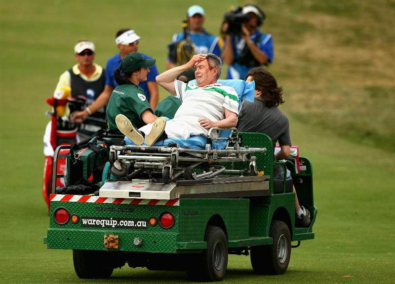 MELBOURNE, AUSTRALIA - NOVEMBER 12:  A spectator is driven away after being hit by the ball of Robert Allenby of Australia during day two of the Australian Masters at The Victoria Golf Club on November 12, 2010 in Melbourne, Australia.  (Photo by Ryan Pierse/Getty Images)