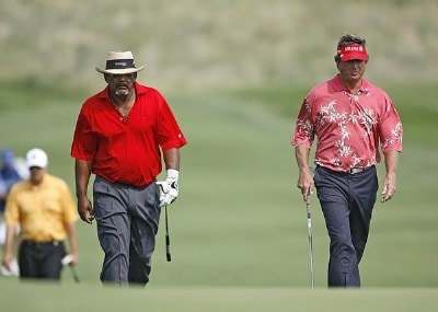 Jim Thorpe and Dana Quigley walk to the green on hole 9 during the first round of the U.S. Senior Open at Prairie Dunes Country Club in Hutchinson,  Kansas on July 6, 2006.Photo by G. Newman Lowrance/WireImage.com
