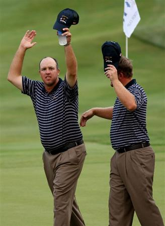 LOUISVILLE, KY - SEPTEMBER 20:  Boo Weekley and J.B. Holmes of the USA team celebrate after their 2 & 1 victory during the afternoon four-ball matches on day two of the 2008 Ryder Cup at Valhalla Golf Club on September 20, 2008 in Louisville, Kentucky.  (Photo by Ross Kinnaird/Getty Images)