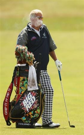 TURNBERRY, SCOTLAND - JULY 19:  John Daly of USA smokes as he waits to play during the final round of the 138th Open Championship on the Ailsa Course, Turnberry Golf Club on July 19, 2009 in Turnberry, Scotland.  (Photo by Ross Kinnaird/Getty Images)